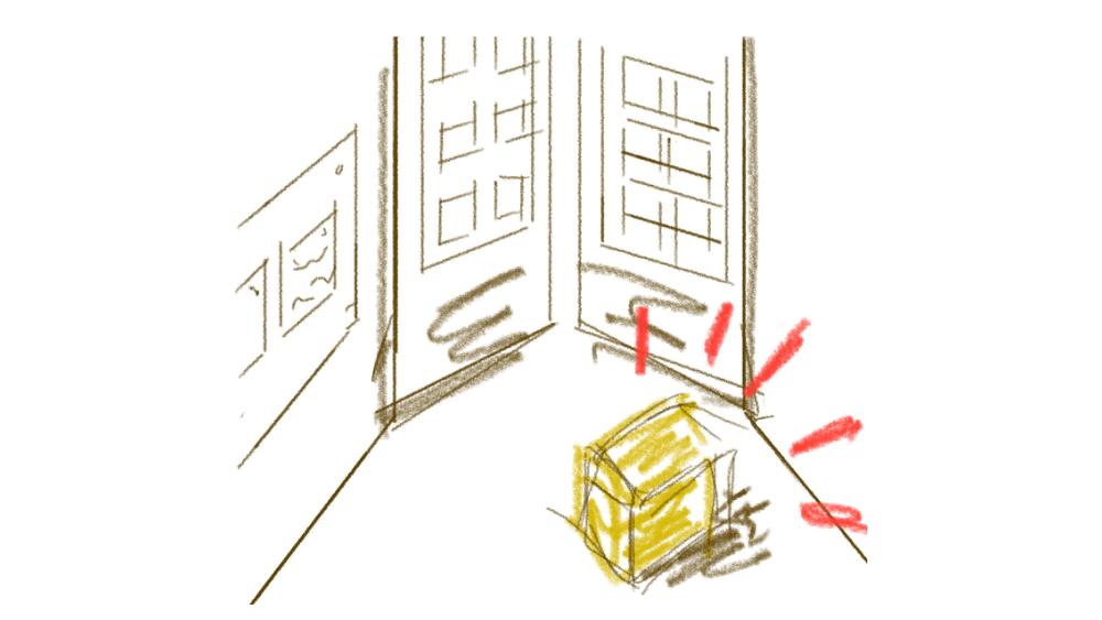 正面玄関前に置かれる荷物